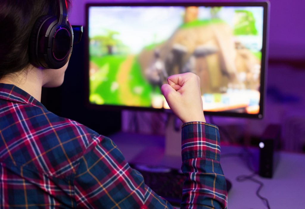 guy in showing his fist while playing video games